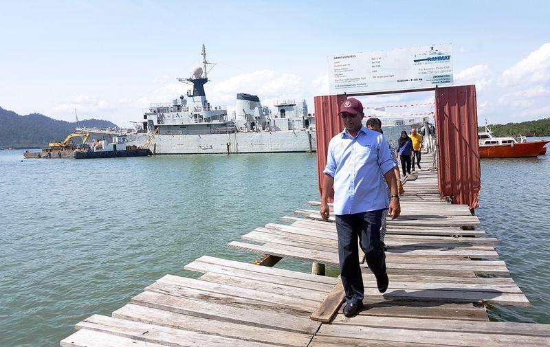 Perak Menteri Besar Datuk Seri Dr Zambry Abdul Kadir observing the successful stabilisation of the Ex KD Rahmat navy vessel near the marina jetty at Lumut, June 6, 2017. — Bernama pic