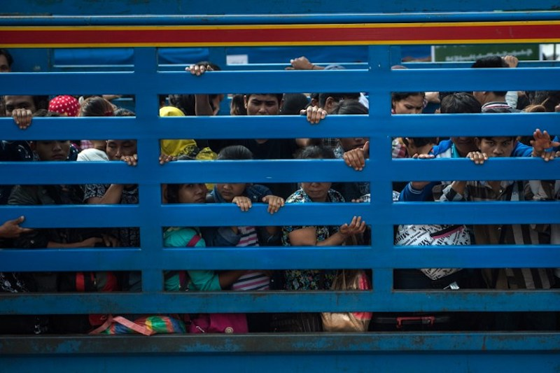 Migrant workers arrive in an official service truck from Thailand at the Myanmar immigration office in Myawaddy July 7, 2017. — AFP pic