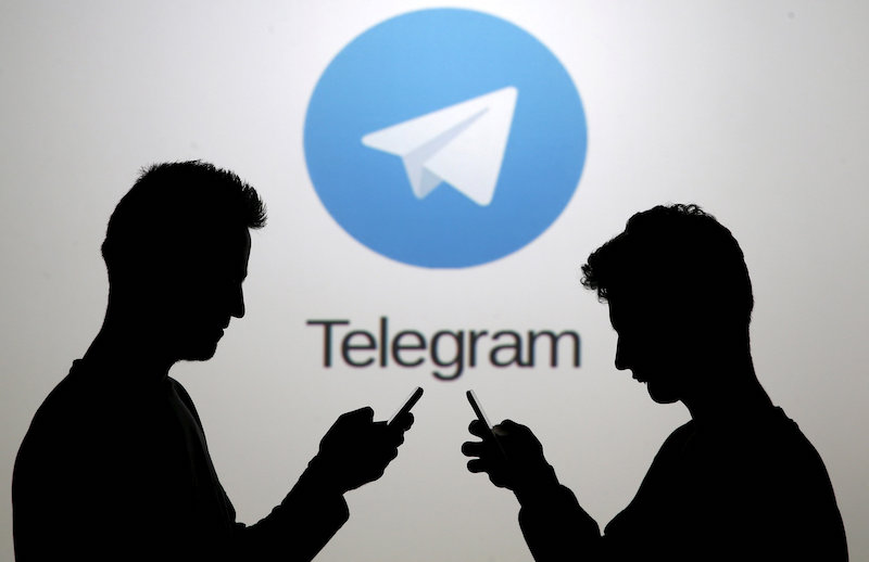 File photo of men posing with smartphones in front of a screen showing the Telegram logo in this picture illustration November 18, 2015. — Reuters pic
