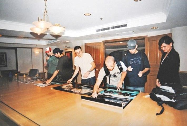 Jojo (right) with Chester (second from right) and Linkin Park at Concorde Hotel, Kuala Lumpur in 2003. — Picture by Mukhriz Hazim