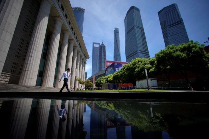 A man walks at Lujiazui financial district of Pudong in Shanghai, China July 17, 2017. — Reuters pic