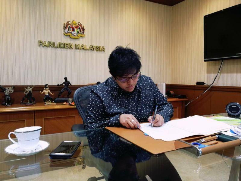 Datuk Seri Azalina Othman Said signs the document at her office in Kuala Lumpur. ― Picture via Facebook/Azalina Othman Said