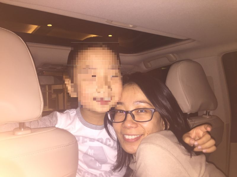 Cheng is shown in 2015 with her son then aged six on the second day of their reunion after over two years of separation.
