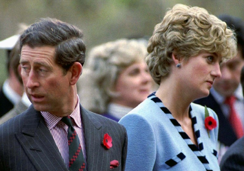 Princess Diana and Prince Charles look in different directions during a Korean War commemorative service in November 1992. — Reuters pic