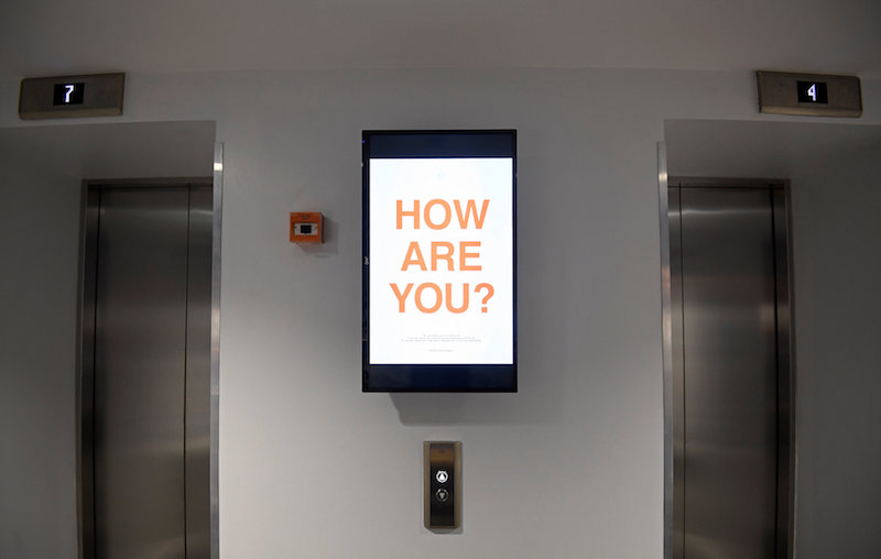 A digital display reminding residents or 'members' to give feedback on their co-living experience is seen in a lift foyer at The Collective co-living building in London August 14, 2017. — Reuters pic