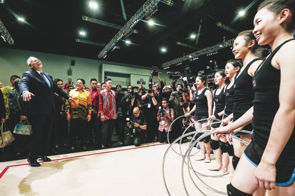 Prime Minister Datuk Seri Najib Razak has words of encouragement for members of the rhythmic gymnastics team at the handing over of Mitec yesterday. — Picture by Hari Anggara