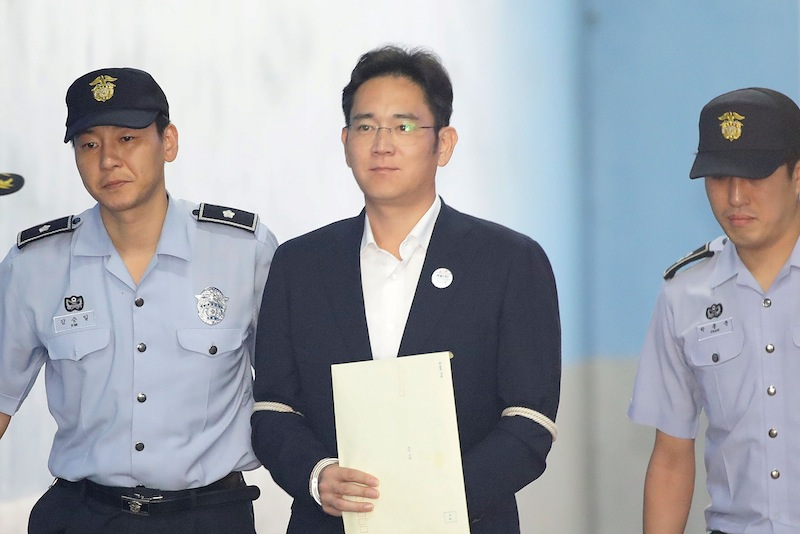 Lee Jae-yong, Samsung Group heir arrives at Seoul Central District Court to hear the bribery scandal verdict on August 25, 2017 in Seoul, South Korea. — Reuters pic