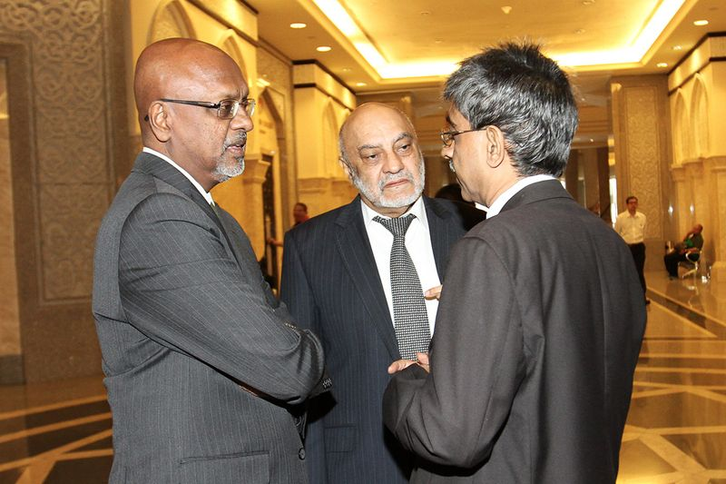 Tun Dr Mahathir Mohamad's lawyers, (from left) Sivarasa Rasiah, Gurdial Singh Nijar and Mohamed Haniff Khatri, outside the Court of Appeal during the RCI on BNM 1990s Forex Losses second hearing at the Palace of Justice, Putrajaya, August 21, 2017. — Picture by Miera Zulyana