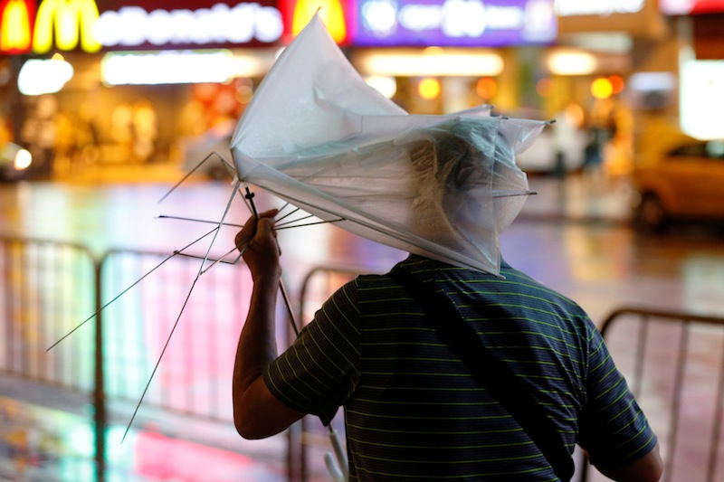 A man carrying a broken umbrella braves strong wind and rains as Typhoon Nesat hits Taipei, Taiwan July 29, 2017. —Reuters pic