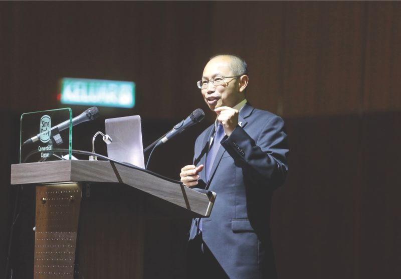 PNB chairman Tan Sri Abdul Wahid Omar said the fund wants to boost its assets under management to RM350 billion by 2022. — Picture by Zuraneeza Zulkifli