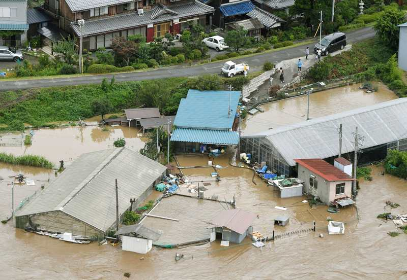 Aerial view showing inundated buildings and structures caused by swollen river, seen in Nagahama, western Japan, hit by heavy rain caused by Typhoon Noru August 8, 2017. — Kyodo pic via Reuters