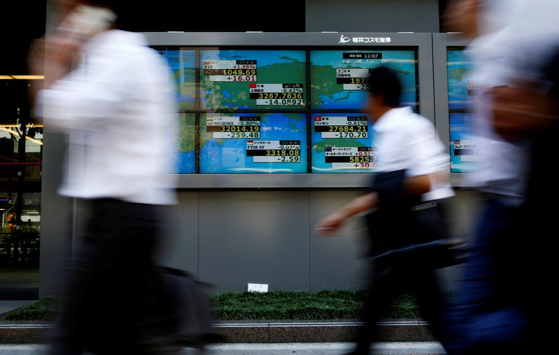 Tokyo's key Nikkei index nosedived nearly 2 per cent at the open before recovering slightly to finish the morning 1.2 per cent down. — Reuters pic