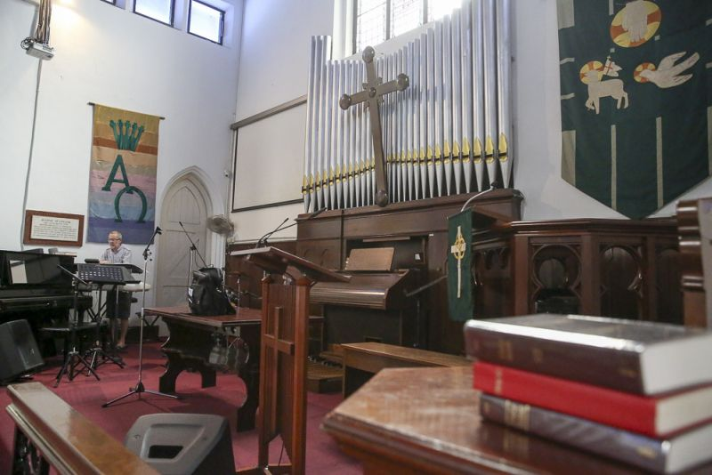 The pipe organ became the first to be fully local-made in 1948 when St Andrew's replaced the original UK-cast pipes that were looted, while the sole memorial tablet that survived the looting can be seen mounted on the left wall. ― Picture by Choo Choy May