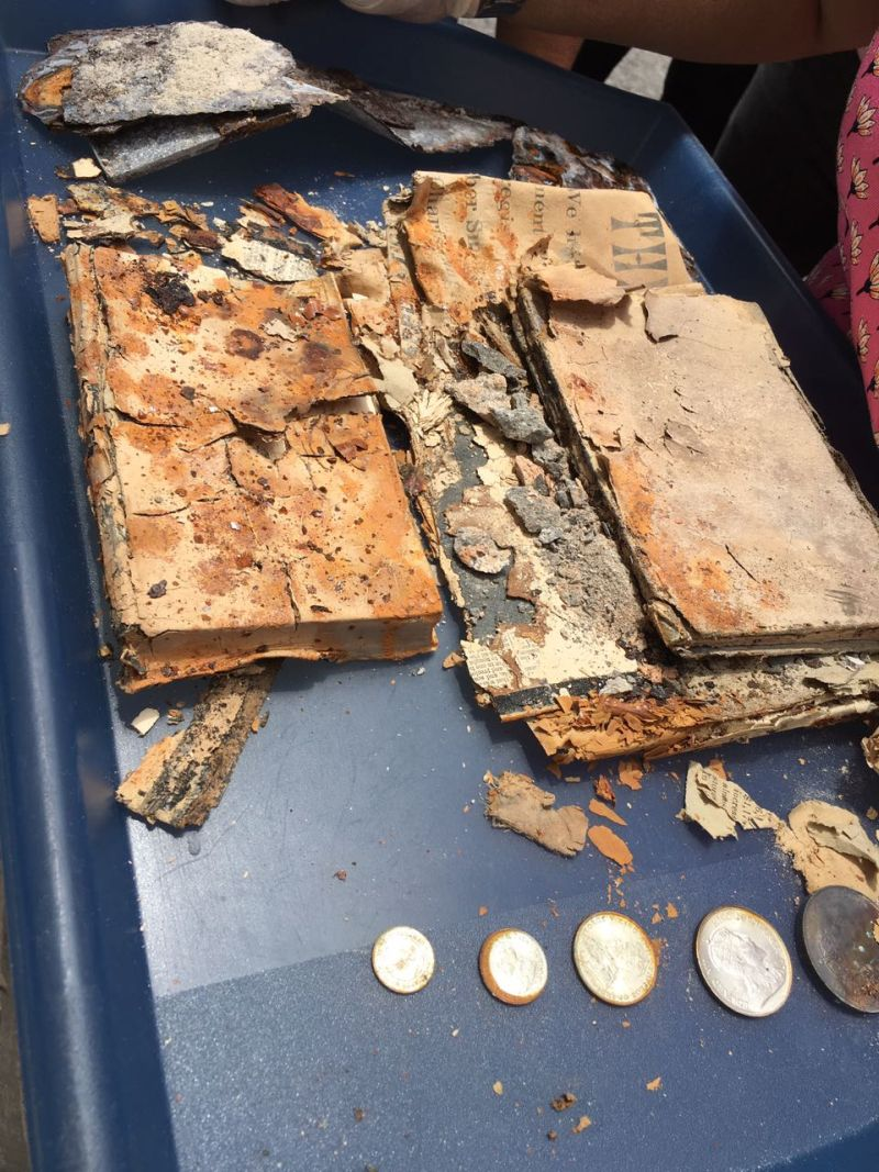The contents of the time capsule including five coins that were then in use in the Federated Malay States that included Selangor. ― Picture courtesy of St Andrew's Presbyterian Church