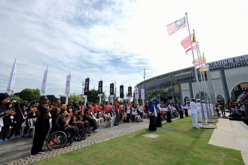 The Jalur Gemilang is raised along with the flags of 10 other contingents taking part in the 9th Asean Para Games in Kuala Lumpur at the Bukit Jalil National Stadium in this file picture taken on September 16, 2017. — Bernama pic