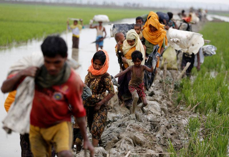 Rohingya refugees walk on the muddy path after crossing the Bangladesh-Myanmar border in Teknaf, Bangladesh, September 3, 2017. — AFP pic