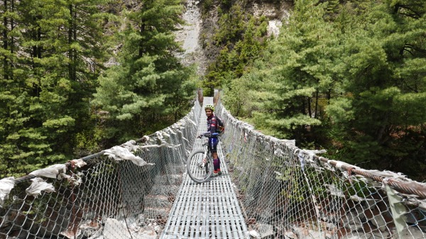 Nur Azhani crosses a suspended bridge on her way to the summit of Annapurna in Nepal. — Picture by Malay Mail