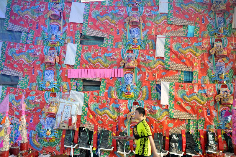 Devotees can also put up paper clothing to Tai Su Yeah as an offering during the Hungry Ghost Festival in George Town September 8, 2017.