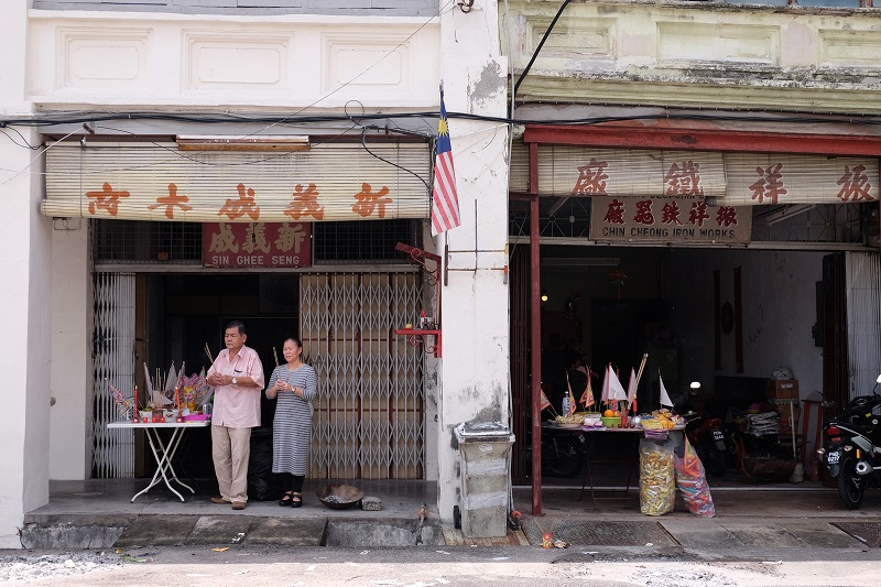 It is common for traders and businesses to set up tables and place offerings to appease the spirits during Hungry Ghost Month.