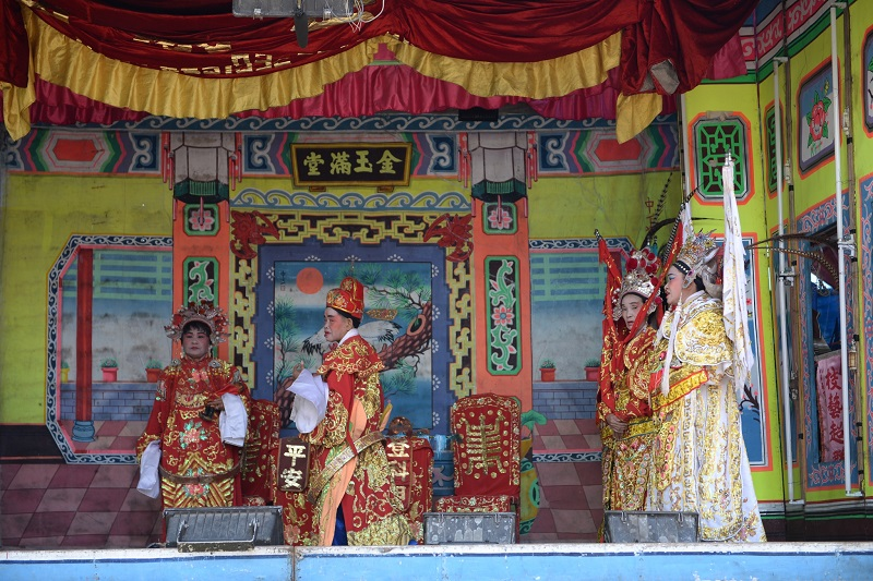 The traditional Chinese opera performance to entertain the hungry ghosts during the seventh lunar month.