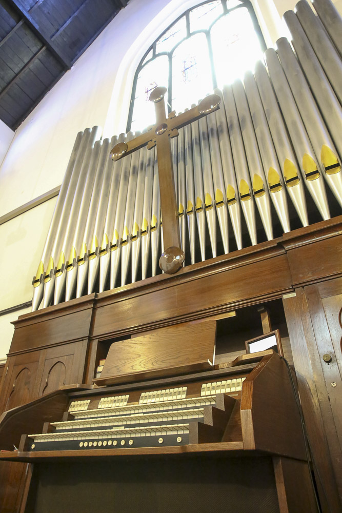 The pipe organ's cross was handcrafted by Malaysian Chinese carpenters using the local hardwood nyatoh and was added in 1992. — Picture by Choo Choy May
