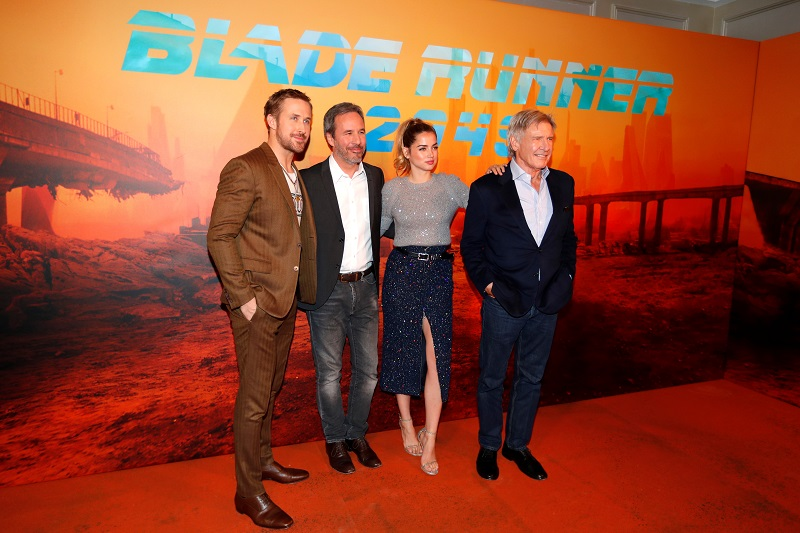 Director of the movie Denis Villeneuve (second from left) and cast members Ryan Gosling (left), Ana de Armas (second from right) and Harrison Ford (right) attend a photocall for the film 'Blade Runner 2049' in Paris September 20, 2017. — Reuters pic