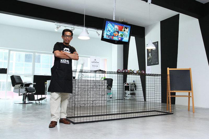 TN Winda Mohd Tahir, owner of BlackWhite Barbershop, poses at his shop in Ara Damansara August 30, 2017. — Picture by Miera Zulyana