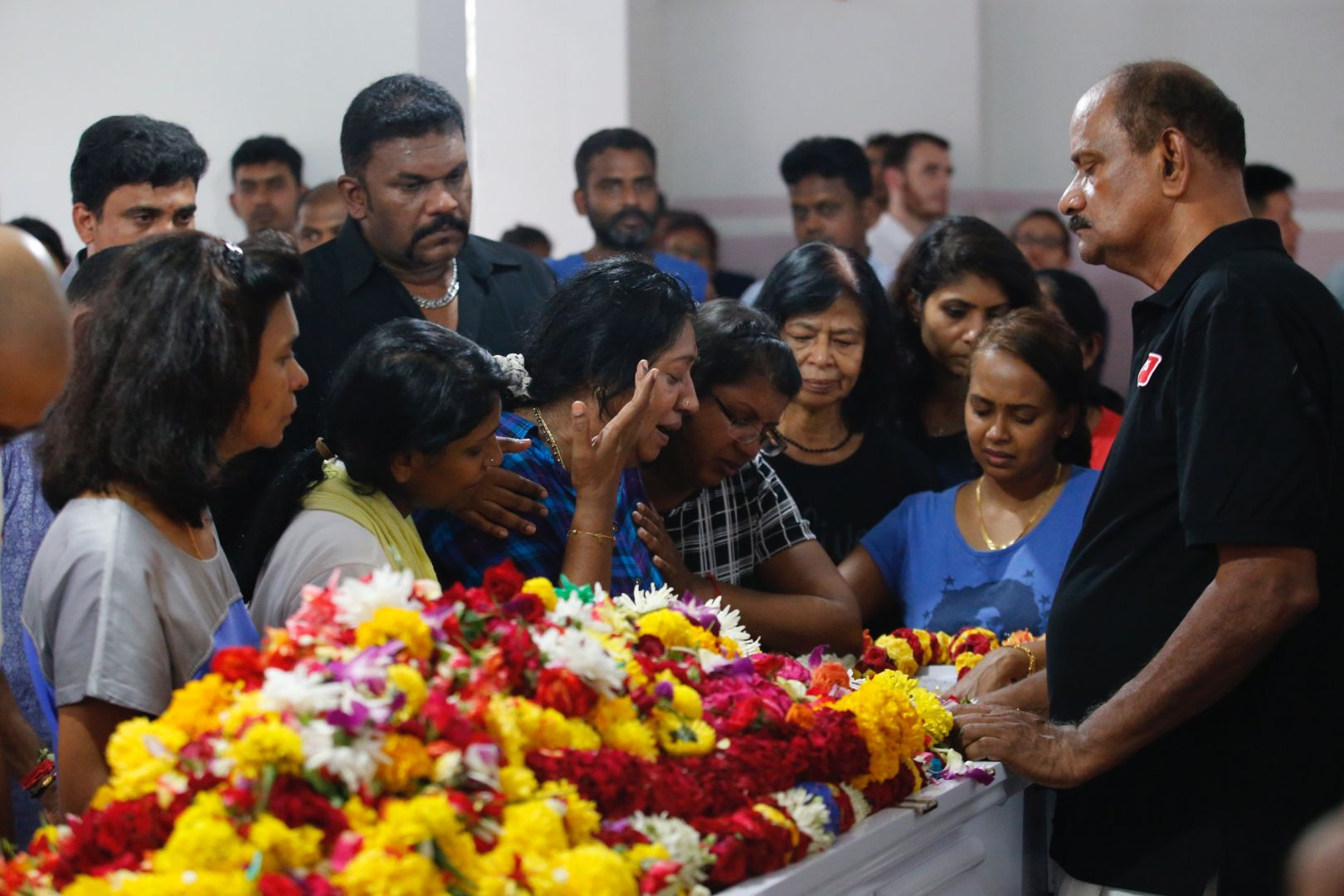 Family members and friends of Pradip Subramanian at the wake of the 32-year-old. — Picture by Najeer Yusof/TODAY