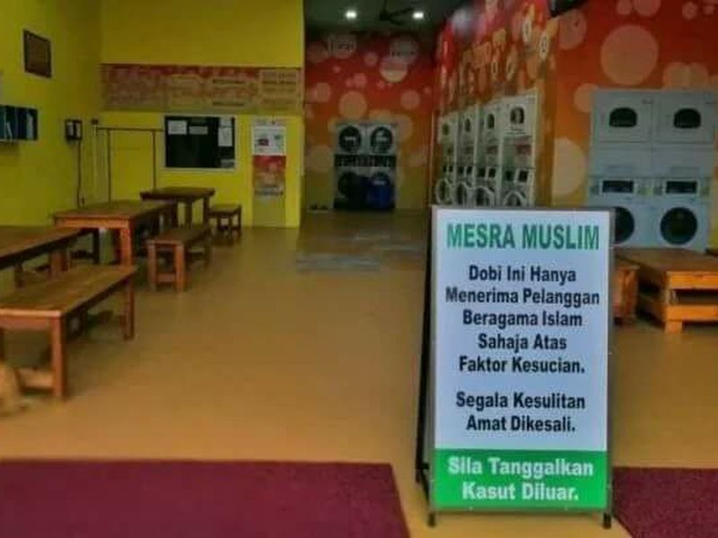 File picture of a laundrette in Muar that displayed the 'Muslim-only' signboard. A local daily claimed that a laundrette with the controversial policy of serving only Muslim customers has also been discovered in Perlis. — Picture via Facebook/Kelab Info Malaysia