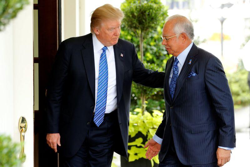 US President Donald Trump welcomes Malaysia's Prime Minister Datuk Seri Najib Razak to the White House in Washington September 13, 2017. — Reuters pic