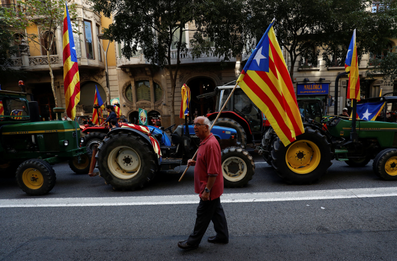 Tractors carrying Catalan separatist flags take part in a protest in favour of the banned referendum on independence from Spain in Barcelona September 29, 2017. — Reuters pic