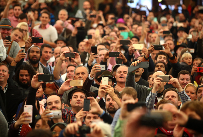 Visitors take pictures with their phones during the opening day of the 184th Oktoberfest in Munich in this file picture taken on September 17, 2017. — Reuters pic