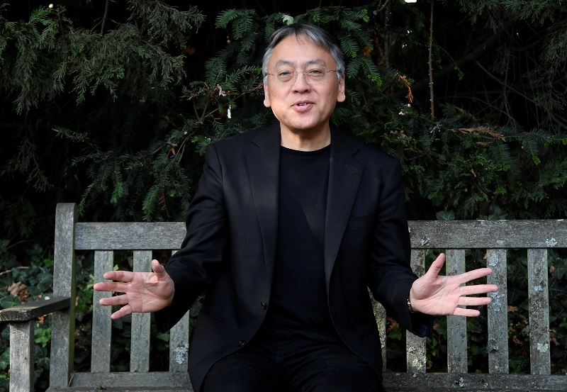 Author Kazuo Ishiguro speaks to the media outside his home, following the announcement that he has won the Nobel Prize for Literature in London October 5, 2017. — Reuters pic
