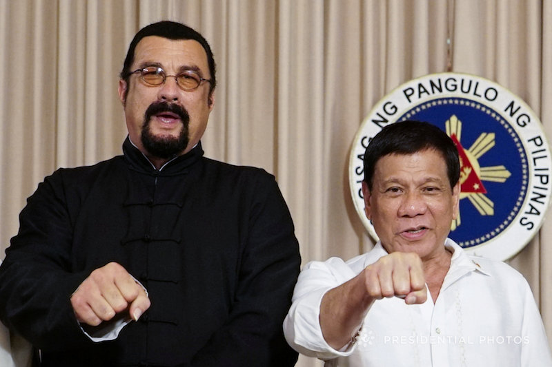 President Rodrigo Duterte with visiting American actor Steven Seagal gestures during his courtesy call at the Malacanang presidential palace in Manila October 13, 2017. — Reuters pic