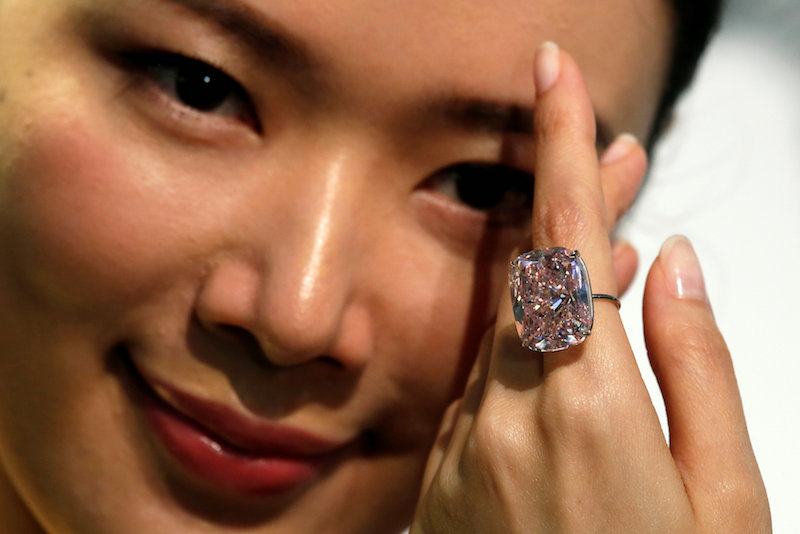 A model poses with a 37.30-carat 'The Raj Pink', the world's largest known fancy intense pink diamond expected to fetch up to US$30 million in an upcoming Geneva auction, during a Sotheby's preview in Hong Kong October 23, 2017. — Reuters pix
