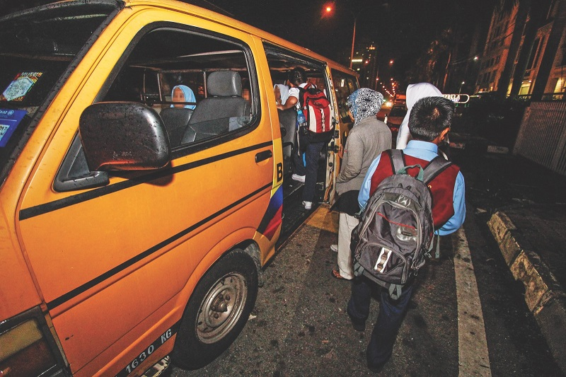 The assistance will be granted to school bus drivers with valid driver licenses and who use registered vehicles from licensed school bus operators. — Picture by Hari Anggara