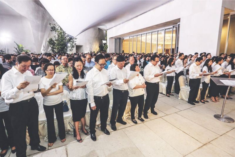Family members and friends during the wake at the residence in Damansara Heights yesterday. — Picture by Hari Anggara