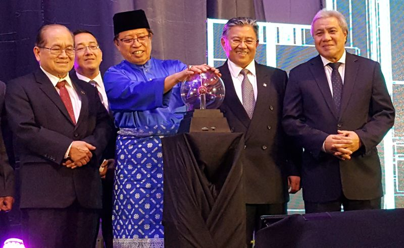 Chief Minister Datuk Patinggi Abang Johari Openg (in blue) launches the Development Bank of Sarawak (DBoS) logo, November 3, 2017. ― Picture by Sulok Tawie