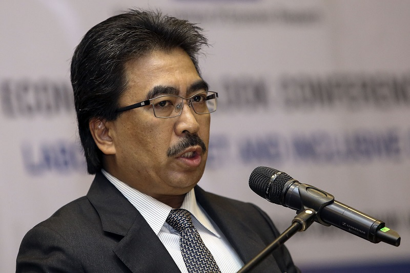 Datuk Seri Johari Abdul Ghani reminded critics that despite 15 out of 54 Umno MPs being 'stolen' by Bersatu, the party still decided to support the PN government. — File picture by Yusof Mat Isa