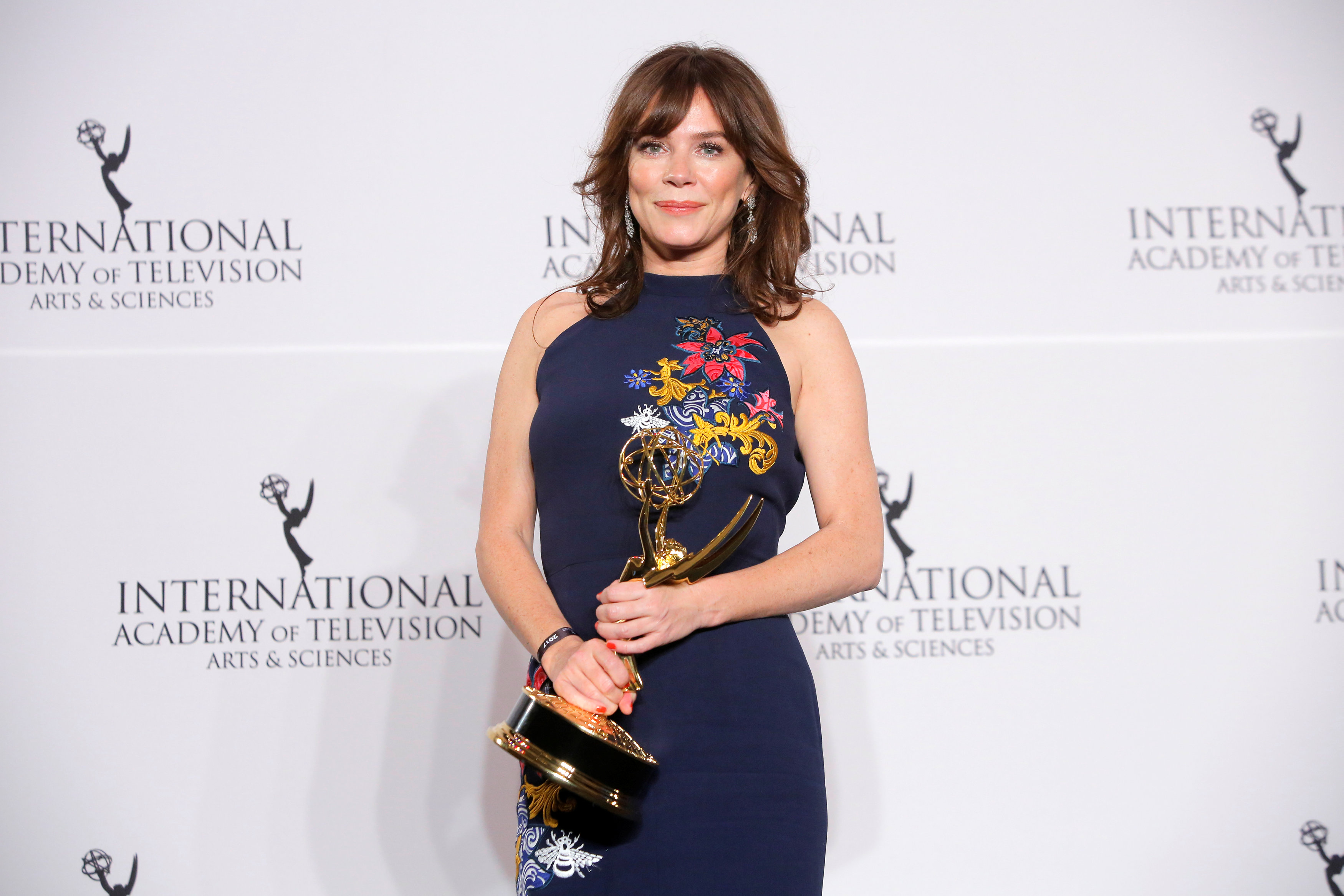 Anna Friel celebrates winning her International Emmy Award for best performance by an actress in 'Marcella' in Manhattan, New York, November 20, 2017. — Reuters pic