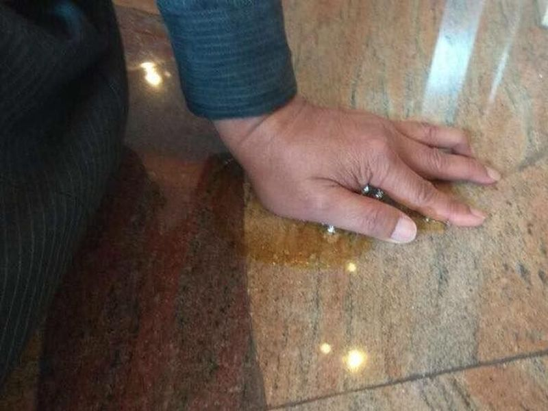 A man superglued his hand to the Caltex headquarters floor in a sign of protest. ― Picture via Facebook/Yusuf Azmi