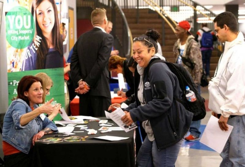 Malaysian workers union are calling for legislation that will prevent employment discrimination. File picture shows a job applicant getting a thumbs up from a recruiter at a job fair in Denver, Colorado.  — Reuters file pic