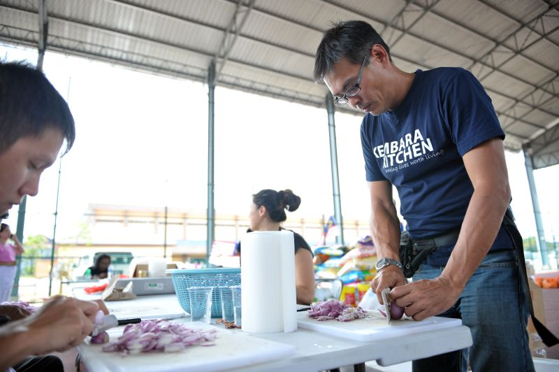 Founder of Kembara Kitchen, William Cheah, (right) helping with the food preparation. ― Pictures by KE Ooi