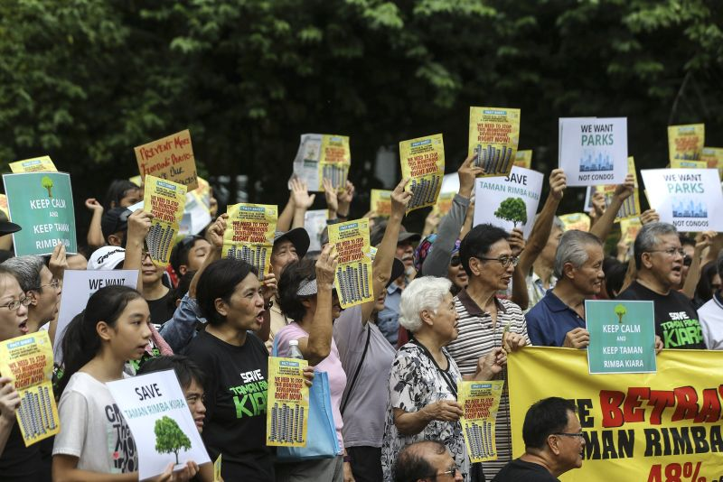 People attend a protest against a proposed condominium project that would encroach into Taman Rimba Kiara in Taman Tun Dr Ismail. ― Picture by Azneal Ishak