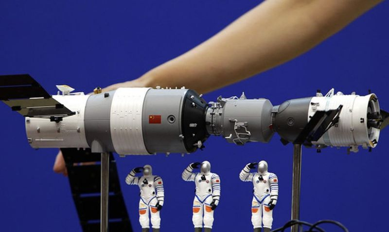 A model of the Shenzhou-9 manned spacecraft ( right) docking with the orbiting Tiangong-1 space lab module (left). — Reuters file pic