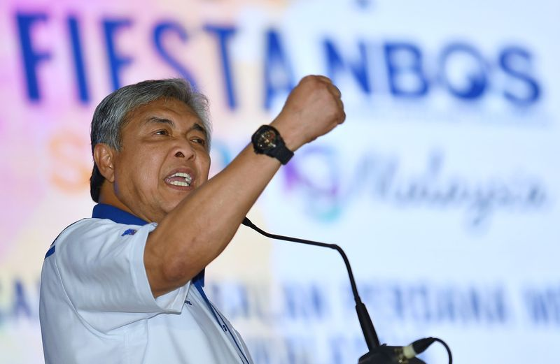 Deputy Prime Minister Datuk Seri Dr Ahmad Zahid Hamidi speaking during the opening of the National Blue Ocean Strategy Fiesta at Padang SMK Hutan Melintang on November 19, 2017. — Bernama pic