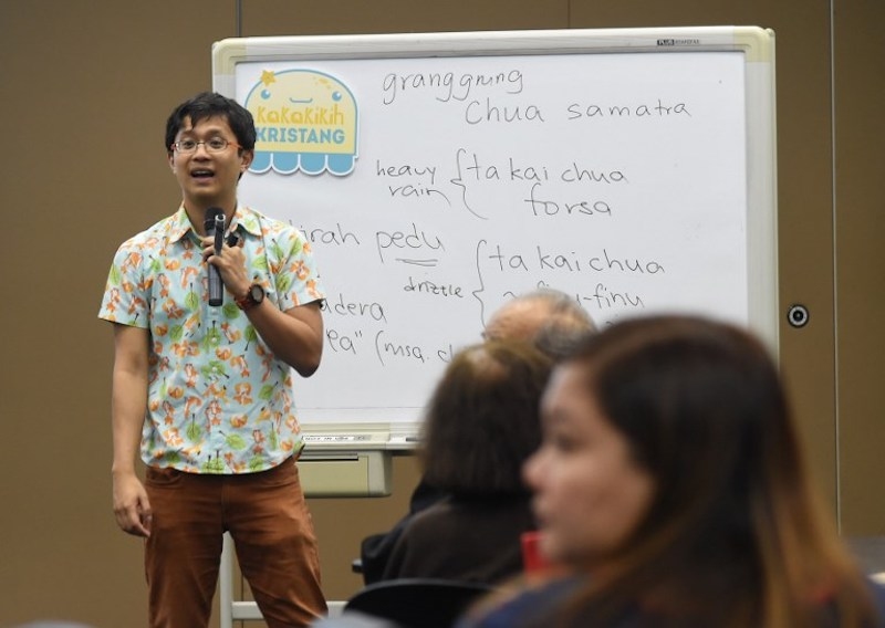 Linguist tutor Kevin Martens Wong conducts a Kristang language class at the National Library Board in Singapore October 19, 2017. — AFP pic