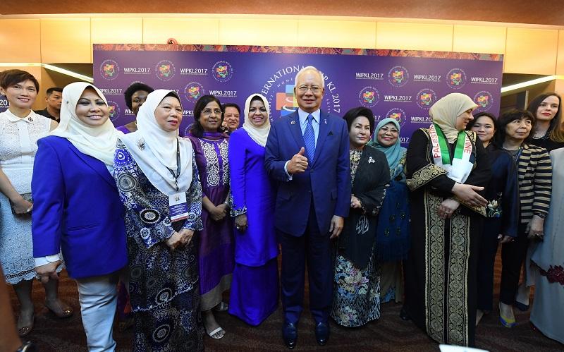 Prime Minister Datuk Seri Najib Razak poses for a photo at the launch of the Women In Politics Kuala Lumpur 2017 conference at the Putra Wold Trade Centre, Kuala Lumpur December 4, 2017. — Bernama pic