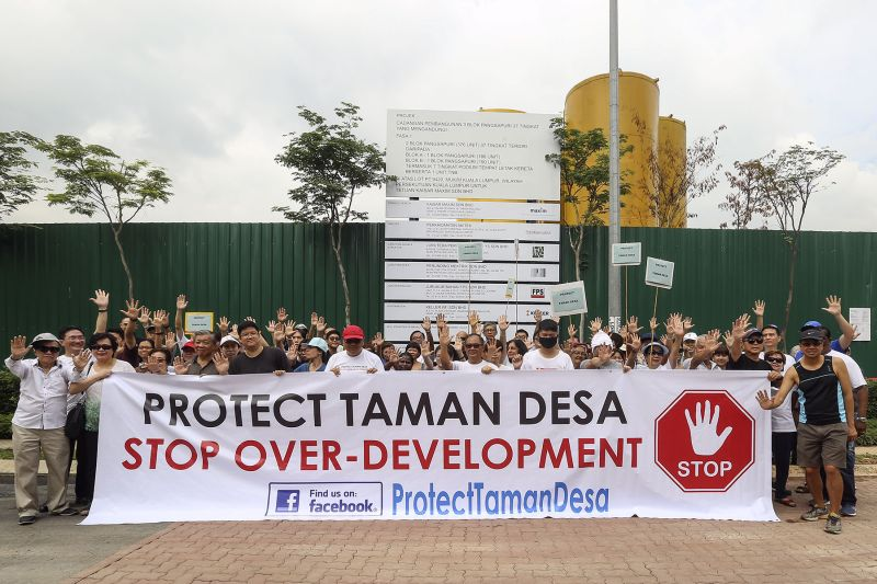 Taman Desa residents are seen holding a banner at The Address's project site to urge for a halt of the alleged over-development of the mature neighbourhood. ― Picture by Yusof Mat Isa
