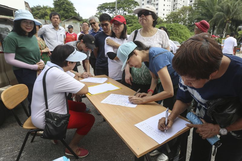 Taman Desa residents are seen signing a memorandum during a protest against a new condominium project at their neighbourhood in Kuala Lumpur. ― Picture by Yusof Mat Isa